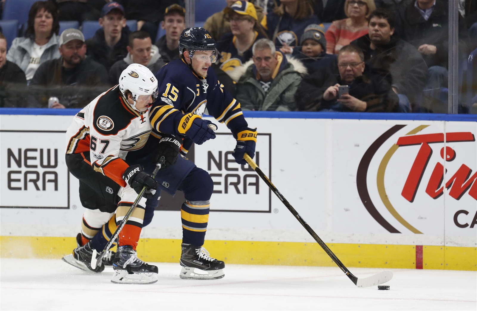 Jack Eichel works against Anaheim's Richard Rakell Thursday night (Harry Scull Jr./Buffalo News).