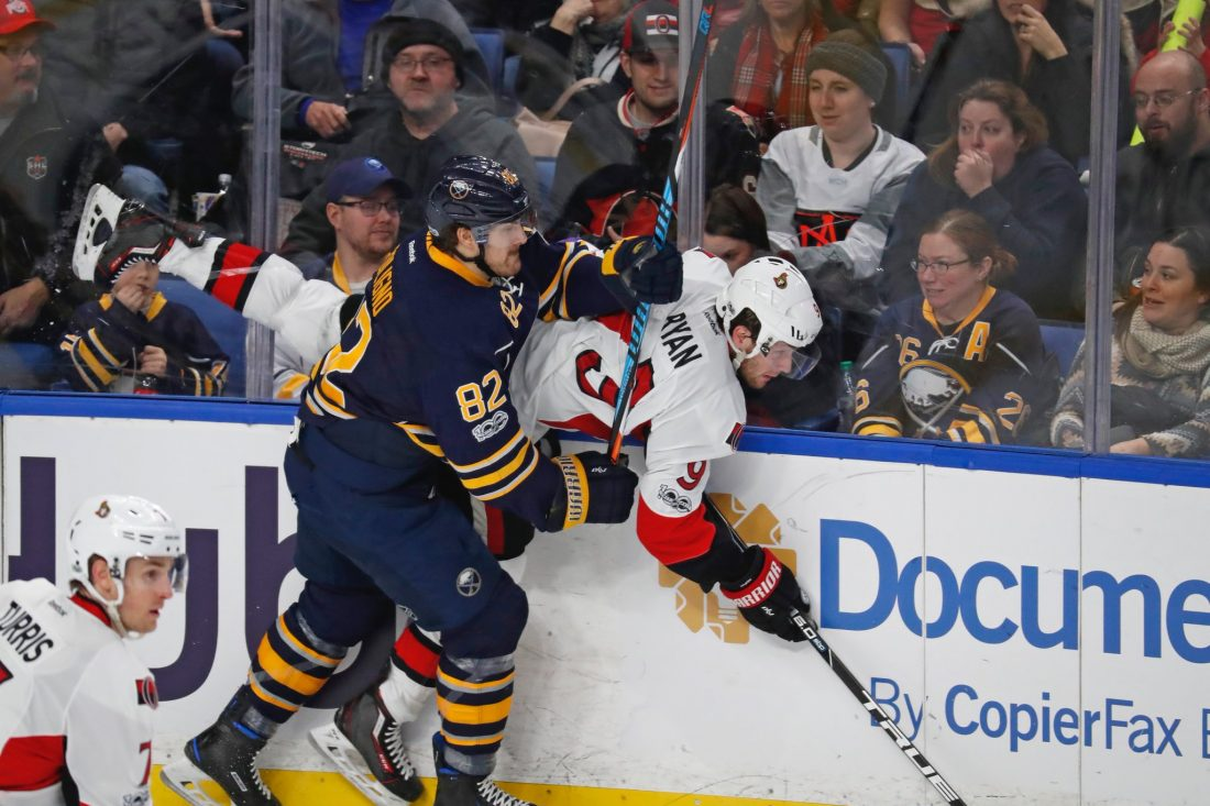 Marcus Foligno checks Ottawa's Bobby Ryan during the Sabres' Feb. 4 win over the Senators in KeyBank Center (Harry Scull Jr./Buffalo News).