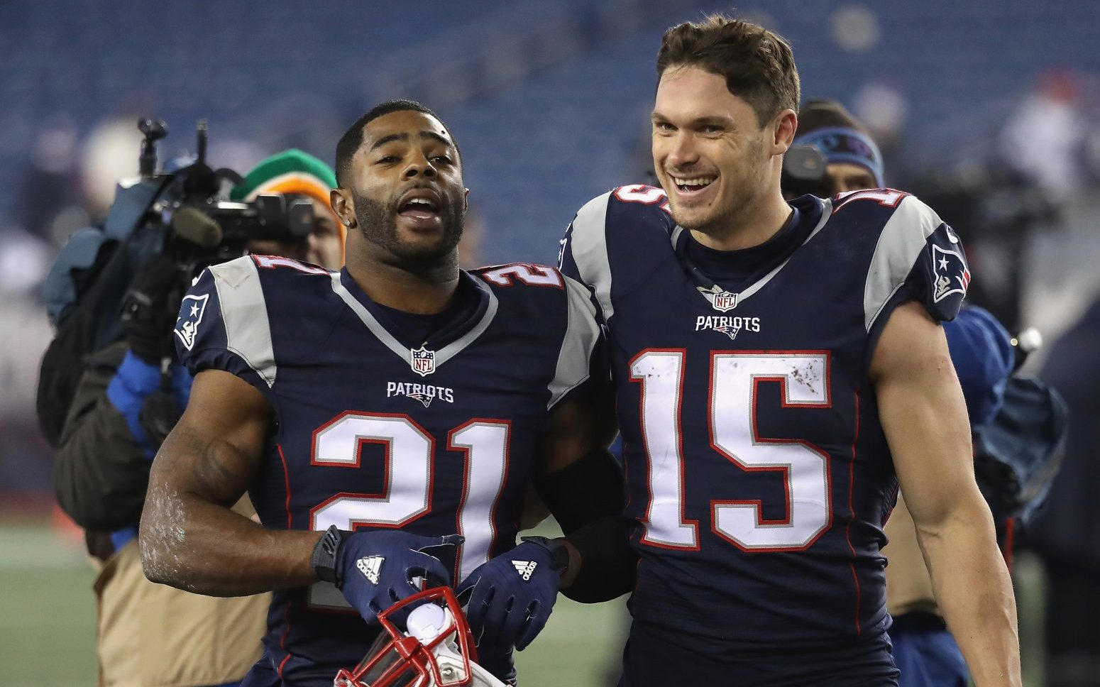Malcolm Butler (21) and Chris Hogan (15) of the New England Patriots react as they walk off the field after defeating the Baltimore Ravens, 30-23, at Gillette Stadium on December 12, 2016. (Getty Images)