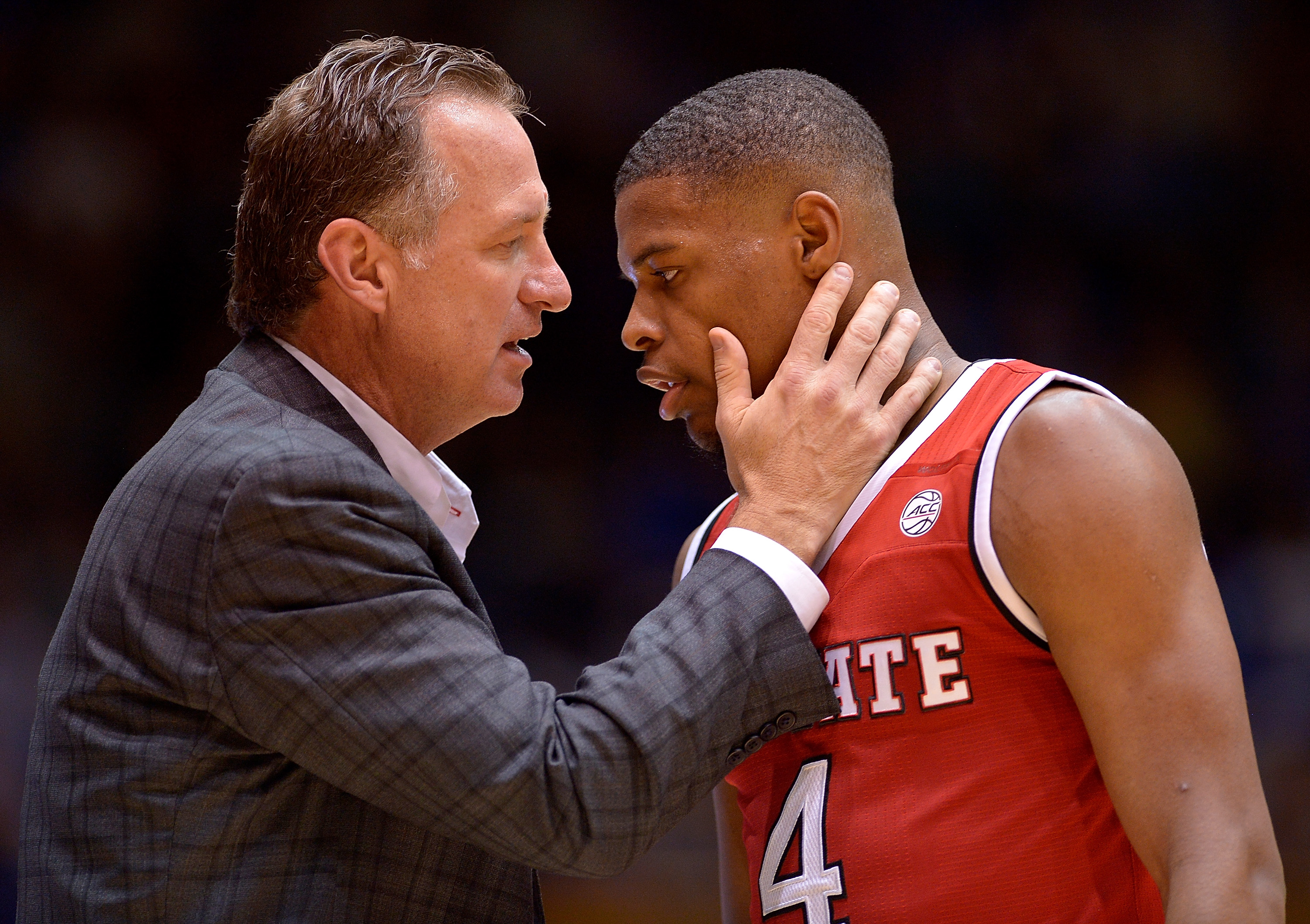 Outgoing N.C. State head coach Mark Gottfried talks to Dennis Smith Jr. during their 84-82 win against Duke at Cameron Indoor Stadium on Jan. 23. (Getty Images)