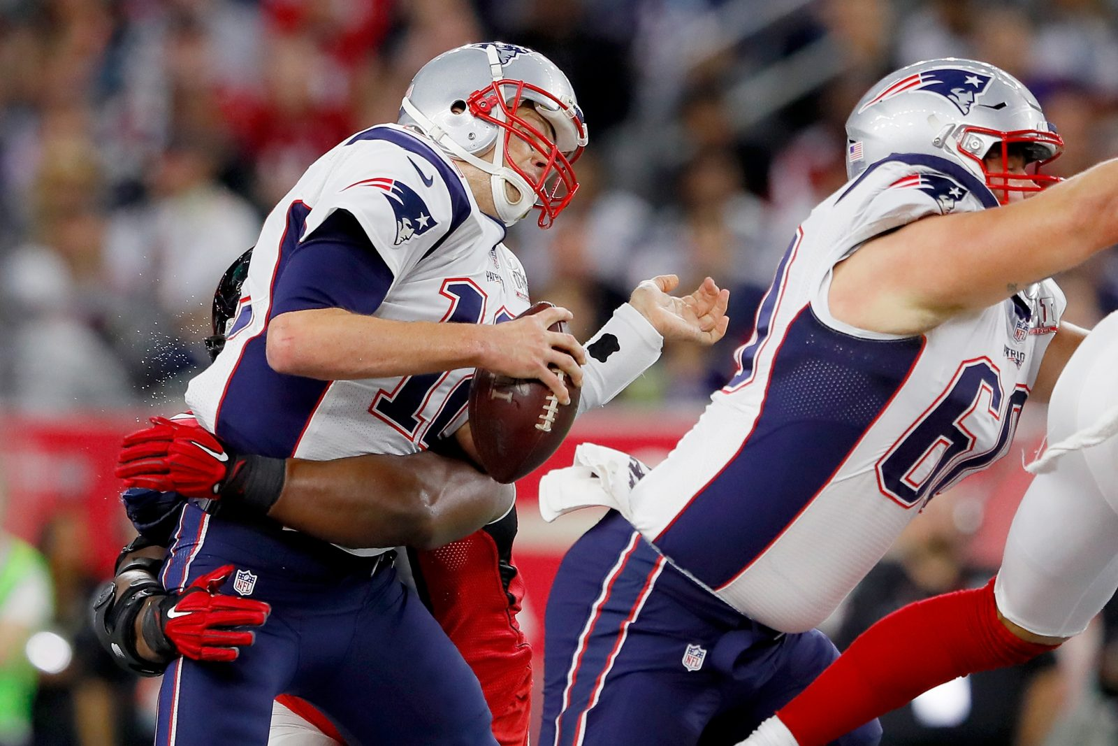 Tom Brady of the New England Patriots is hit in the first quarter against the Atlanta Falcons during Super Bowl 51. (Getty Images)