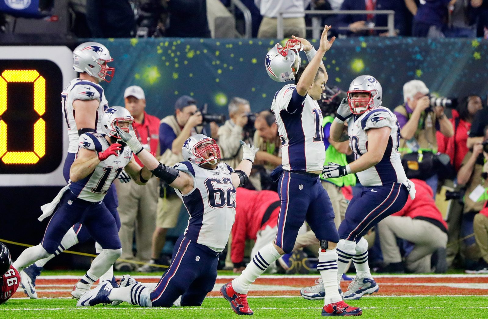 Tom Brady (12) and the New England Patriots react after their game-winning touchdown in overtime. (Getty Images)