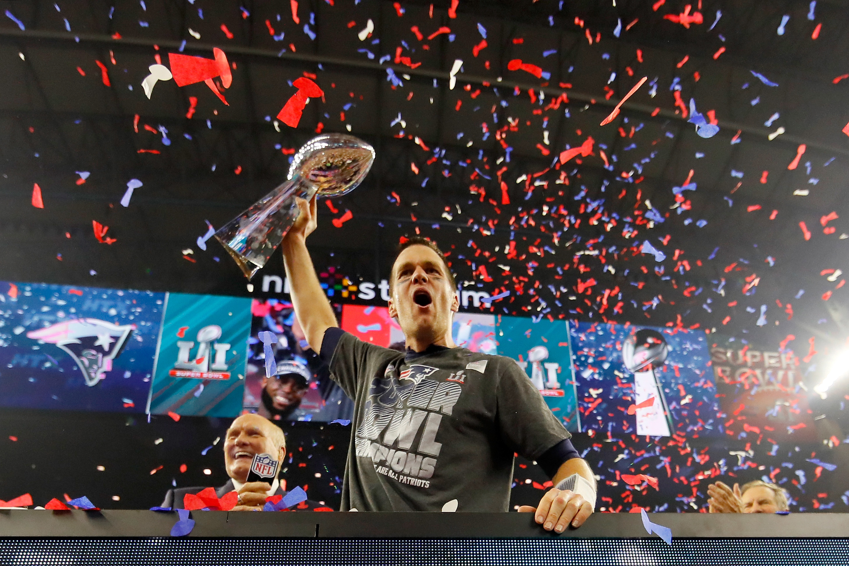 Tom Brady celebrates with the Vince Lombardi Trophy after NFL commissioner Roger Goodell handed the trophy to Patriots owner Bob Kraft. (Getty Images)