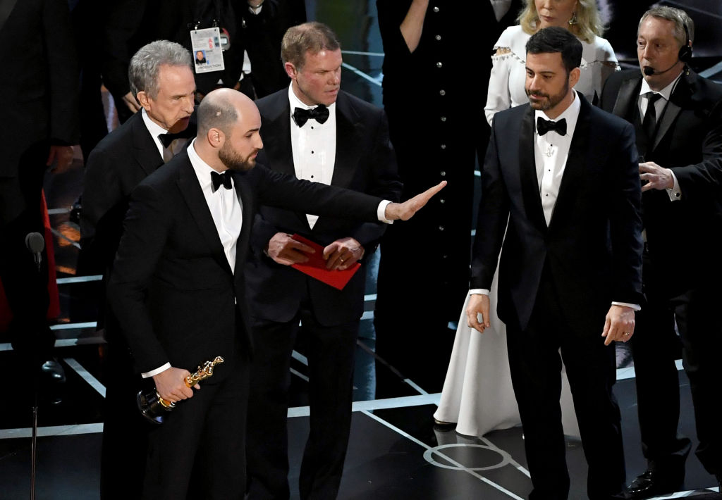 La La Land producer Jordan Horowitz (C) stops the show to announce the actual Best Picture winner as Moonlight following a presentation error with actor Warren Beatty (L) and host Jimmy Kimmel (R) onstage during the 89th Annual Academy Awards in Hollywood, Calif. (Kevin Winter/Getty Images)