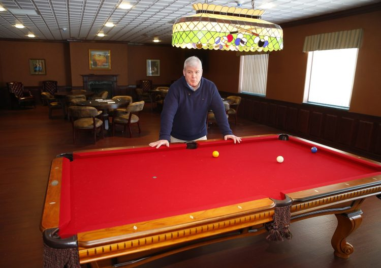 Martin Denecke, director of Hamburg's  Youth, Recreation and Senior Services, shows off the billiard and game room in this file photo taken before the Senior Community Center opened. (John Hickey/Buffalo News)