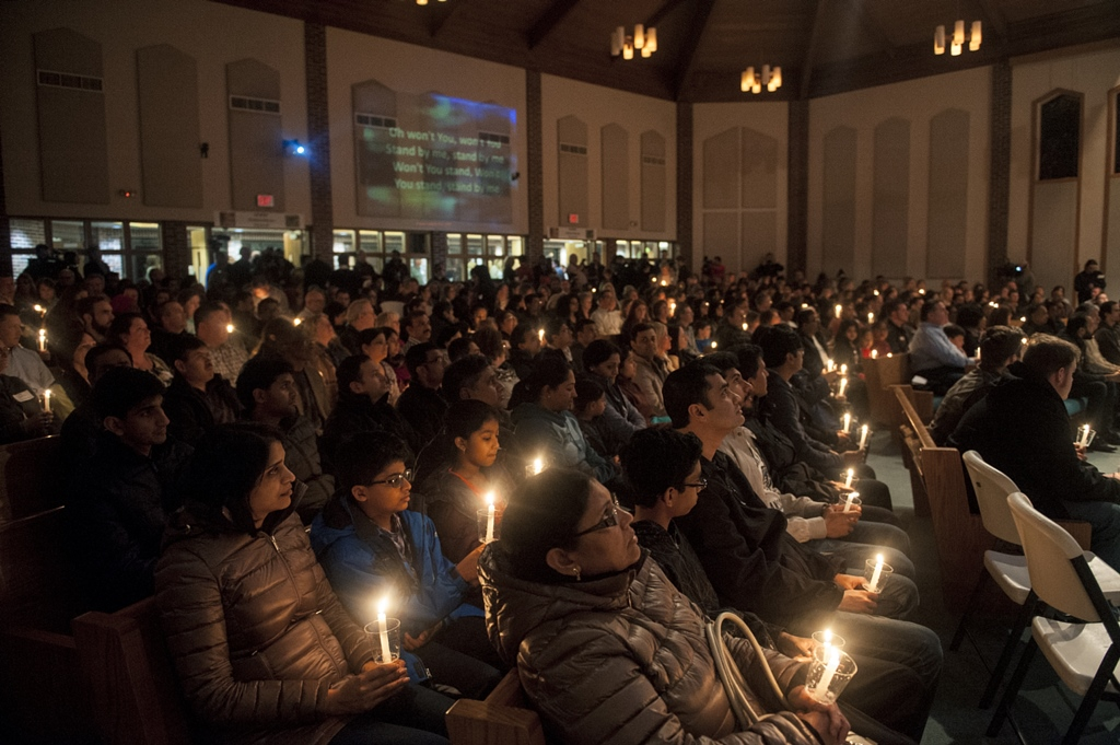 A vigil is held for Srinivas Kuchibhotla and other victims of a mass shooting two nights prior, at the First Baptist Church in Olathe, Kan., Feb. 24, 2017. Kansas reeled on Friday as the shooting escalated into an international incident amid fears that the attack was motivated by bias and hate. (Amy Stroth/The New York Times)