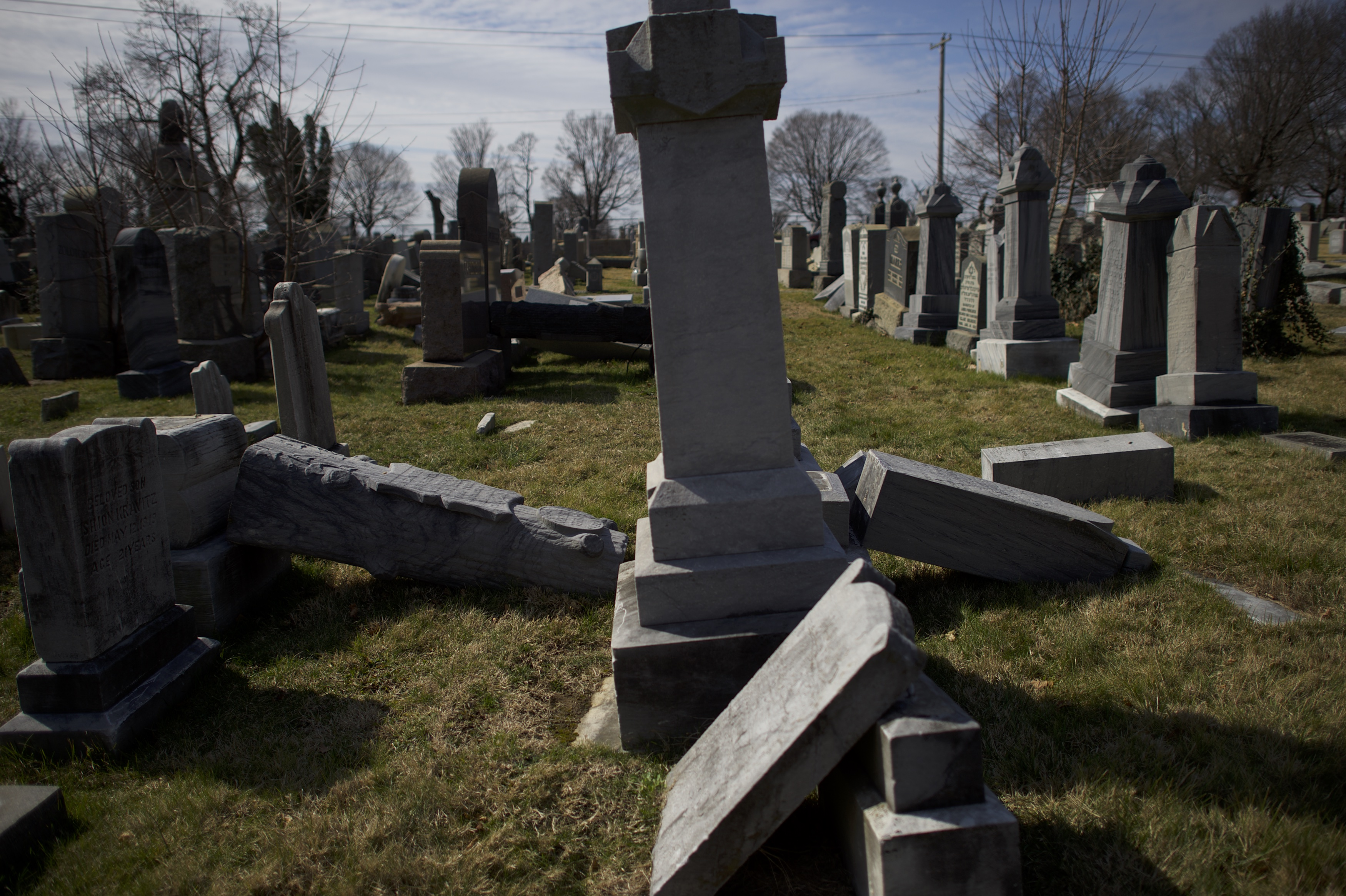 PHILADELPHIA, PA - FEBRUARY 27:  Jewish tombstones lay vandalized at Mount Carmel Cemetery February 27, 2017 in Philadelphia, Pennsylvania.  Police are investigating 75-100 gravestones that were damaged by vandals yesterday. (Photo by Mark Makela/Getty Images)