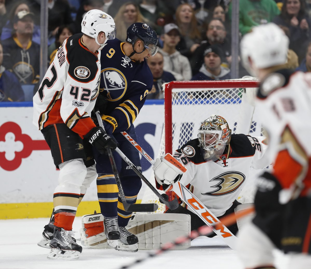 Evander Kane works against Ducks defenseman Josh Manson and goalie John Gibson (Harry Scull Jr./Buffalo News).