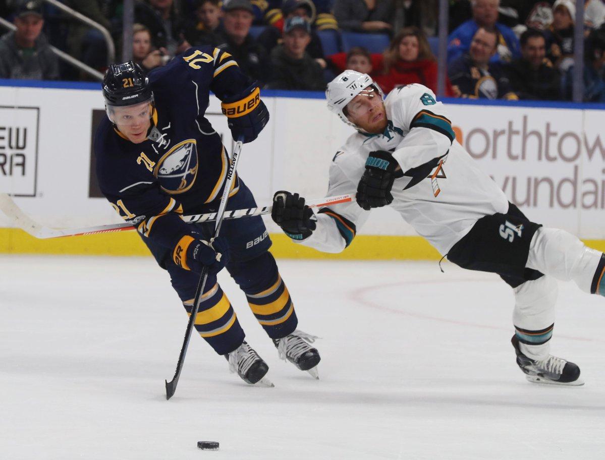 Kyle Okposo battles San Jose's Joe Pavelski (James P. McCoy/Buffalo News).