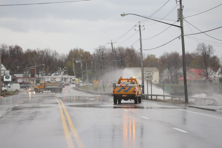 Waves pushed by high winds crash over Route 5 in Athol Springs in Hamburg. (File photo/John Hickey/Buffalo News)