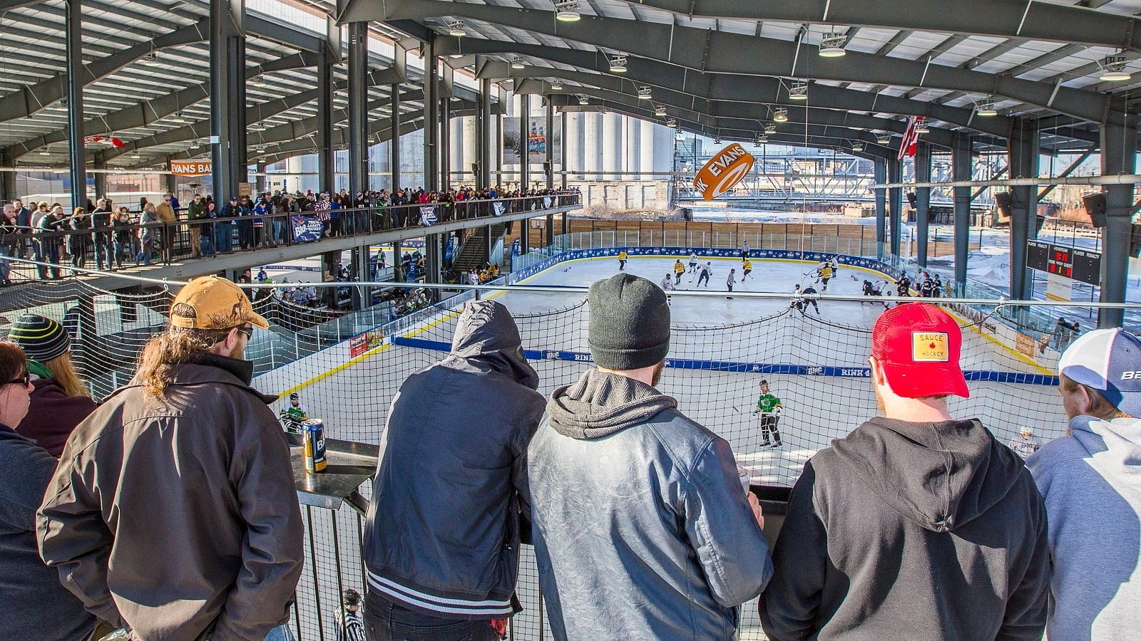 Fans gaze over the ledge at Buffalo RiverWorks to check out the Labatt Blue Pond Hockey Tournament in 2016. (Don Nieman/Special to The News)