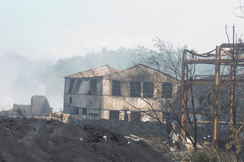 A News file photo from last August shows the smoldering remains of the tire recycling facility in Lockport where the body of Joe Phillips was found. (John Hickey/News file photo)