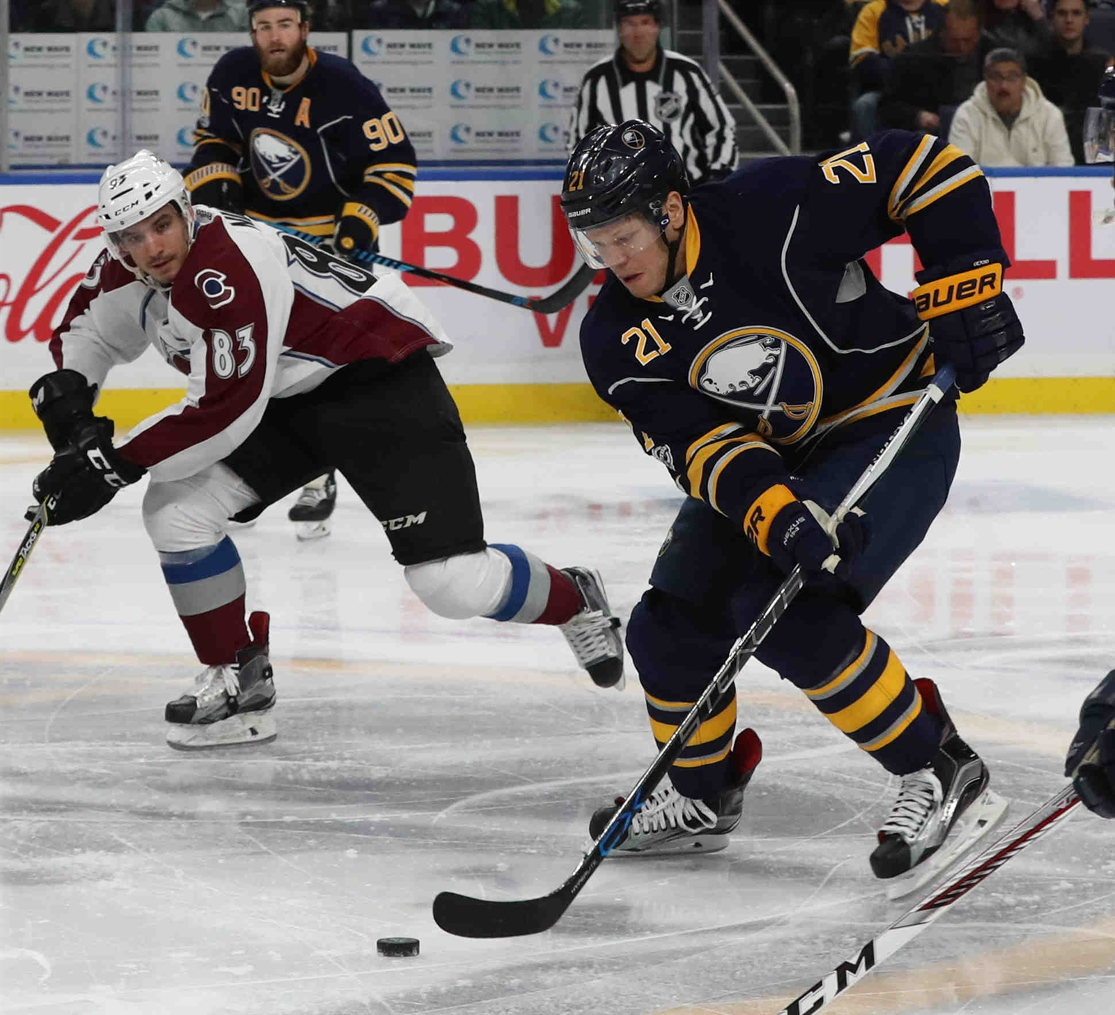 Kyle Okposo works the puck against Colorado's Matt Nieto during the Sabres' 2-0 win over the Avs last week in KeyBank Center. The teams meet again Saturday in Denver (James P. McCoy/Buffalo News).