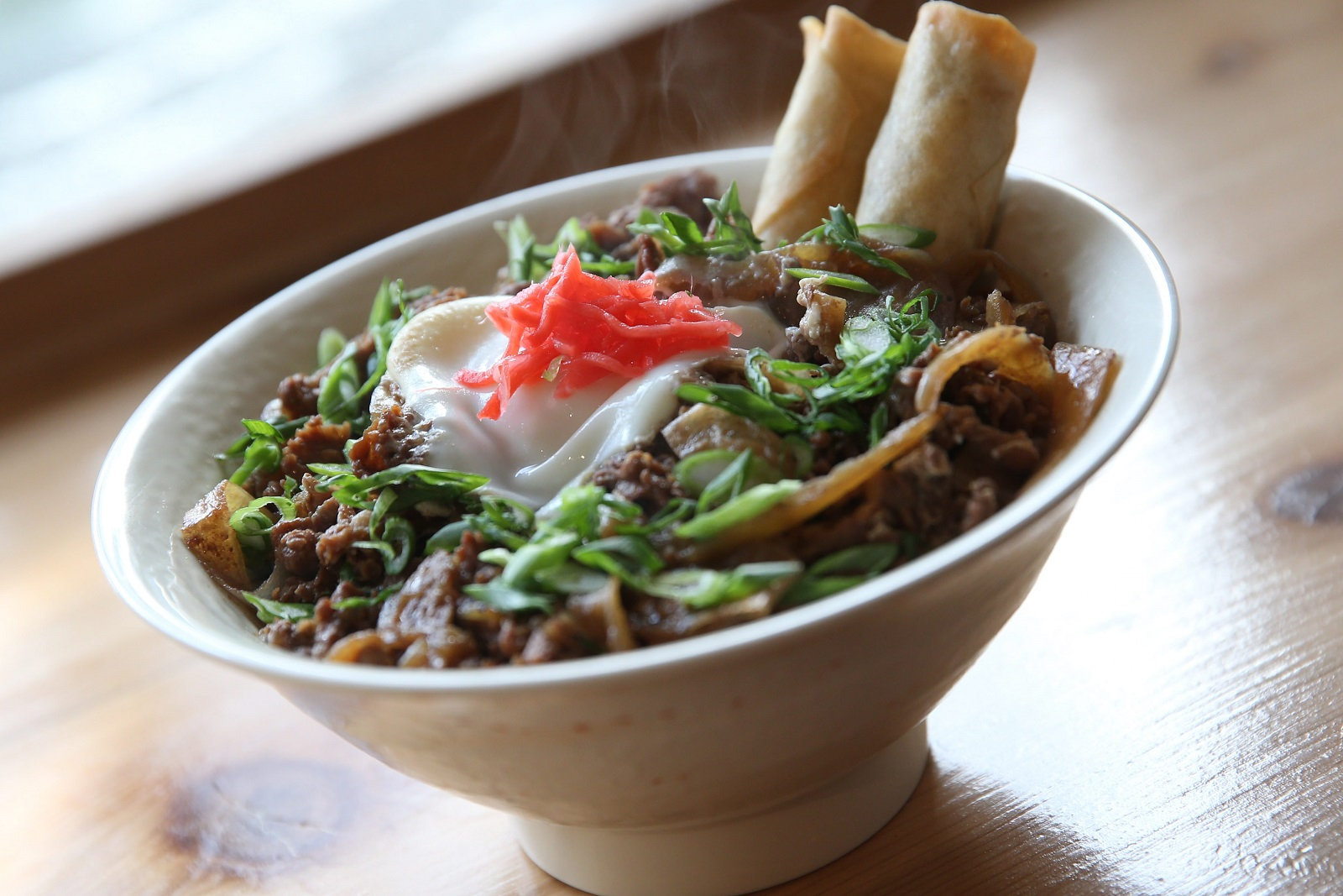 Sato Ramen's Gyu Don is thinly sliced beef and onion simmered in a mild sweet sauce, topped with an egg,  green onions and pickled ginger. (Sharon Cantillon/Buffalo News file photo)