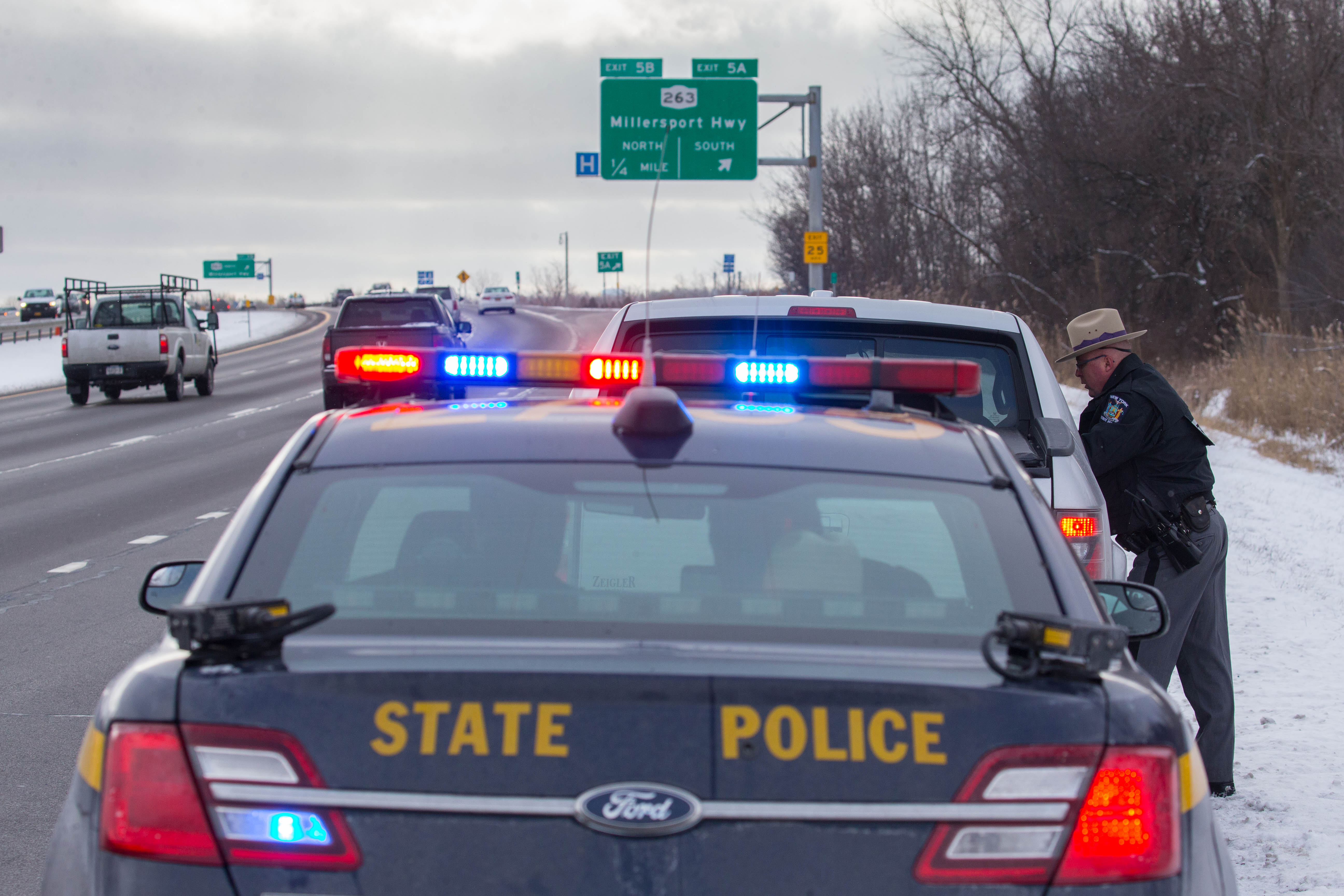 New York State Trooper John Betker talks to a motorist he pulled over for speeding while patrolling Interstate-290 in Amherst on Monday, Jan. 30, 2017.  Amherst Town Court collects more revenue, most of it from  traffic fines, than all but three of the 1,219 town and village courts in New York. (Derek Gee/Buffalo News)