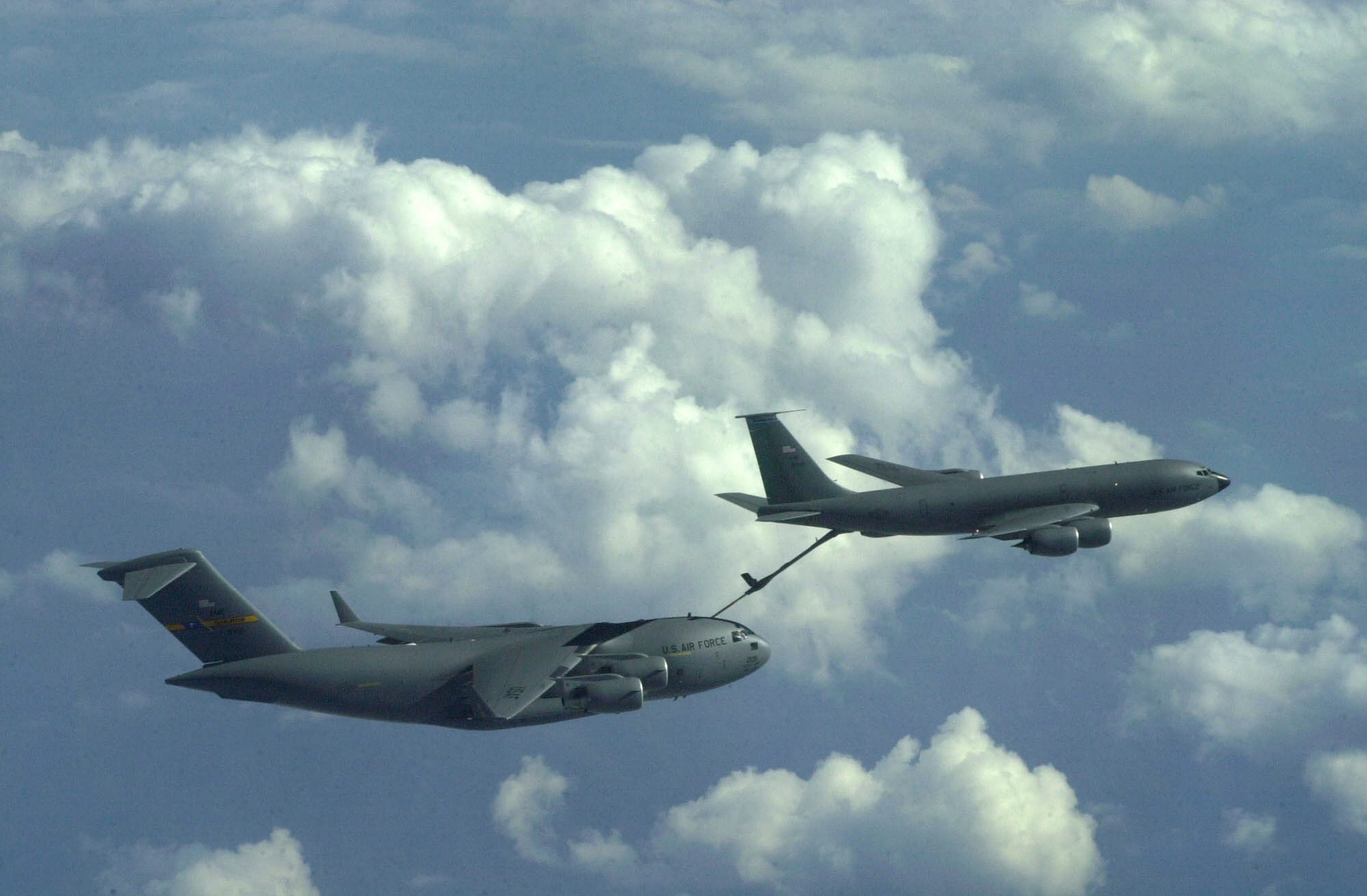 A KC-135R Stratotanker (right) from the 107th Air Refueling Wing in Niagara Falls refuels a C-17 Globemaster III cargo jet at 29,000 feet in the skies over Georgia during a training mission on Oct. 2, 2002. (Derek Gee/Buffalo News)