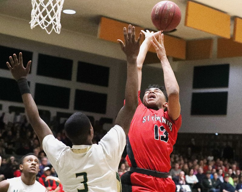 Bishop Timon/St. Jude's Davion Warren blocks the shot of St. Francis' Roburt Welch in the first half of their game this past week. Will they meet again soon?  (James P. McCoy/Buffalo News)