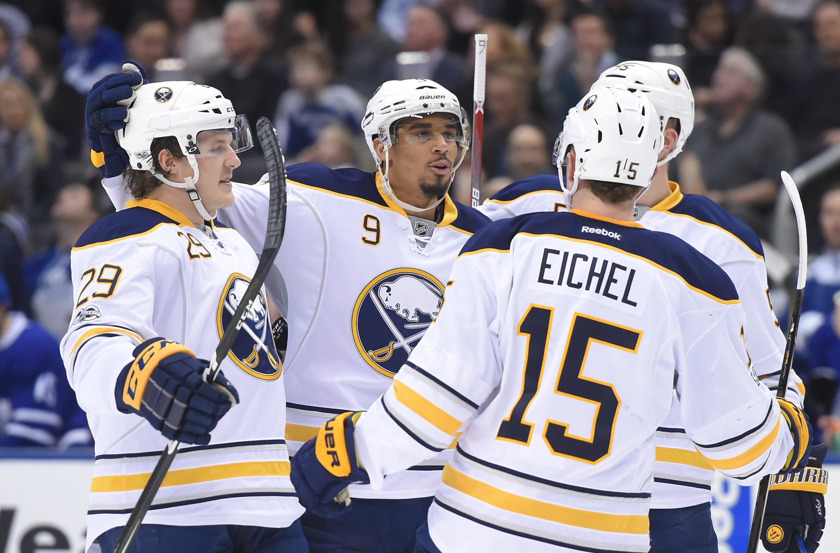 Evander Kane (9) celebrated two goals Saturday, including one with Jake McCabe and Jack Eichel. (USA Today Sports)