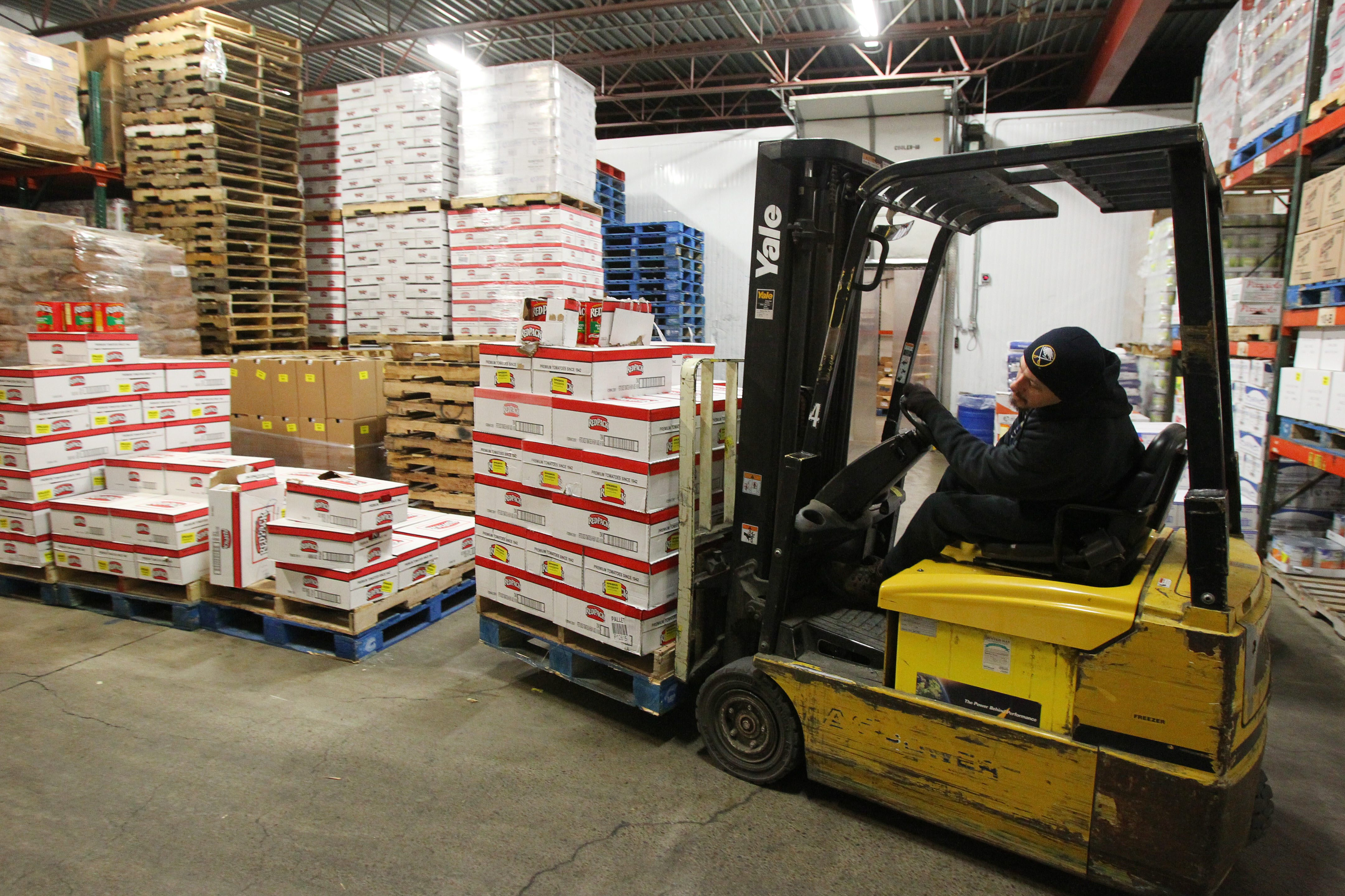 An employee moves products in the warehouse at Will Foods in Buffalo in January 2014.  (Mark Mulville/Buffalo News)