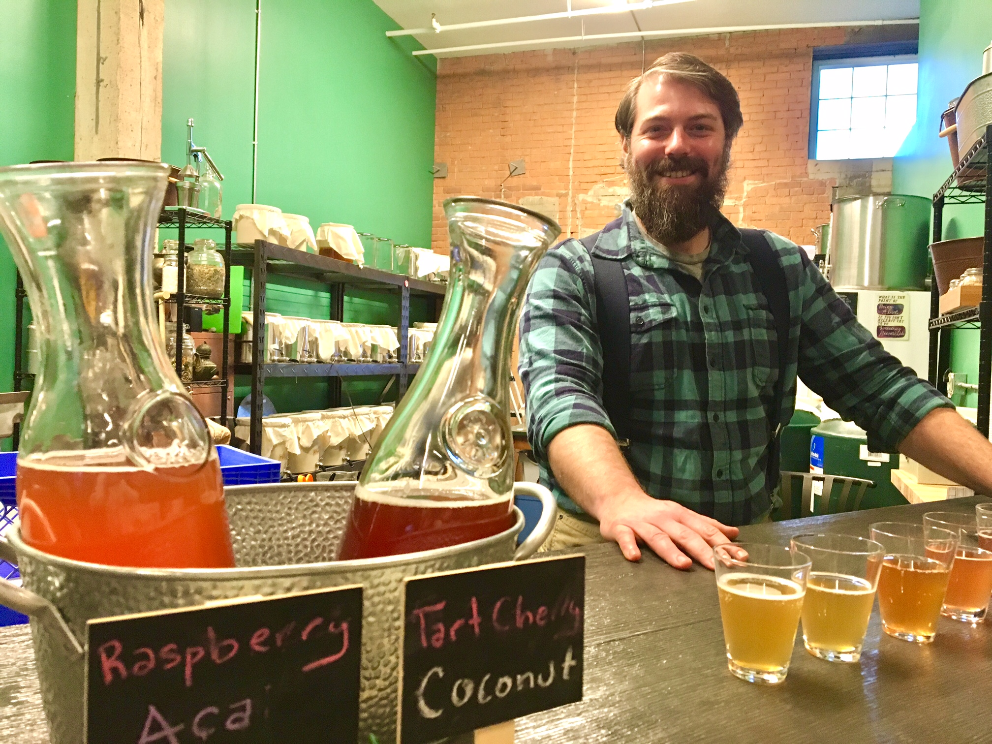 """Some of our customers include people with autoimmune conditions like rheumatoid arthritis or fibromyalgia. They tell us it seems to have a positive effect,"" says Andrew Bannister, co-owner of Snowy Owl Kombucha in The Barrel Factory. (Scott Scanlon/Buffalo News)"