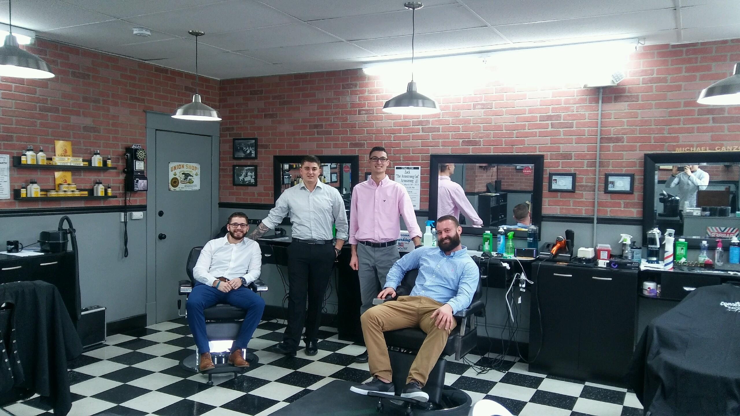 Vinny Caci, Joe Canzoneri, Michael Canzoneri and Zach Armstrong are master barbers. (Contributed photo)