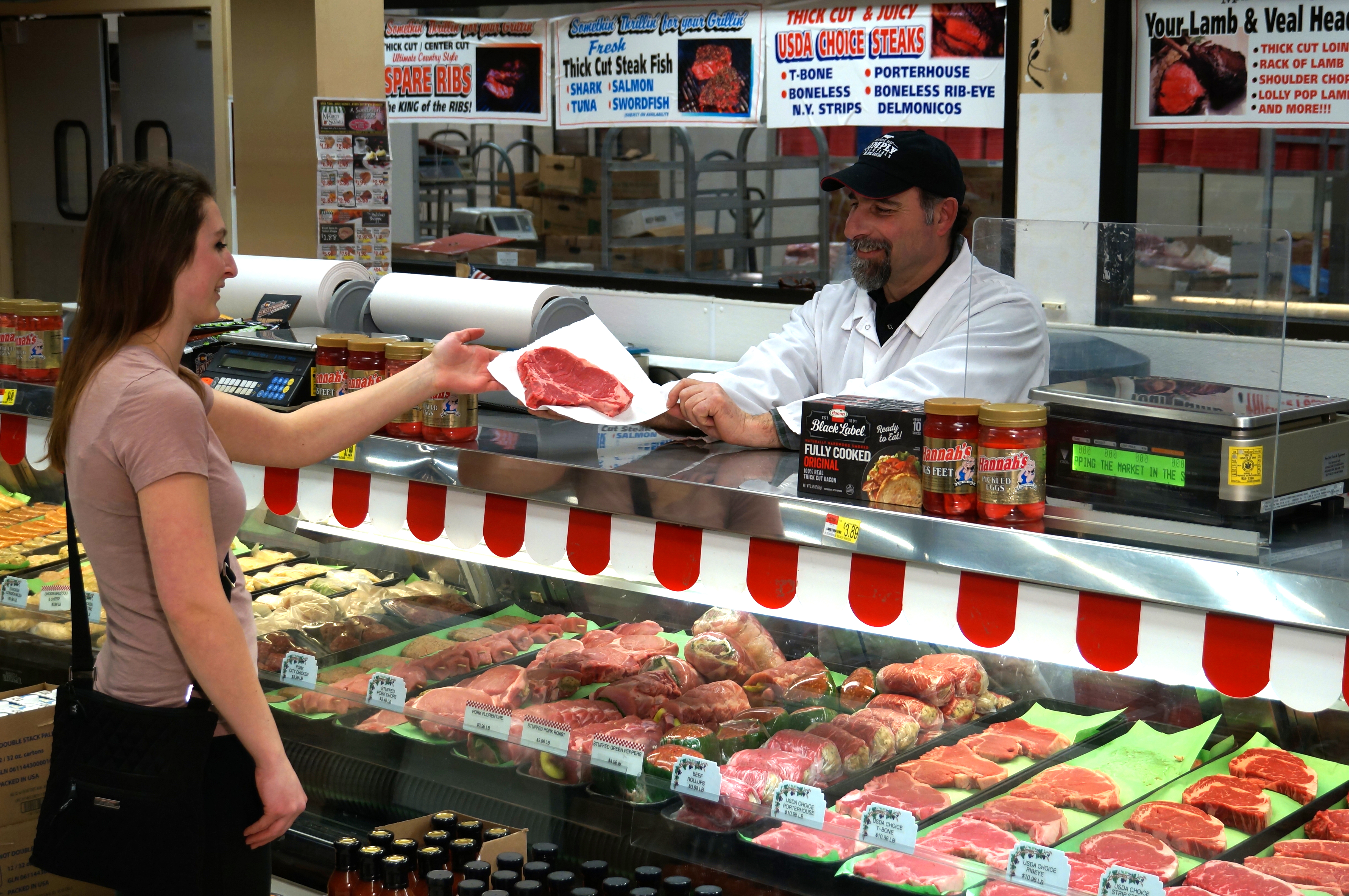 Butcher Tony Sorrento serves a customer at Market in the Square. (Contributed Photo)