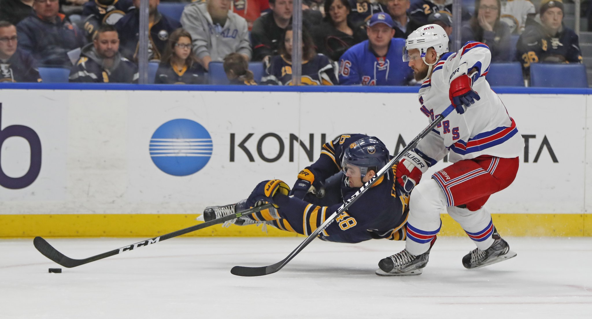 William Carrier forces Kevin Klein into a first-period tripping penalty. (Harry Scull Jr./Buffalo News)