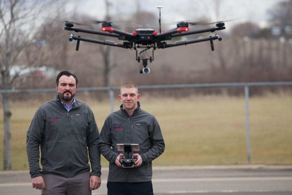 Patrick Walsh (left) and Will Schulmeister of EagleHawk fly one of the company's drones.