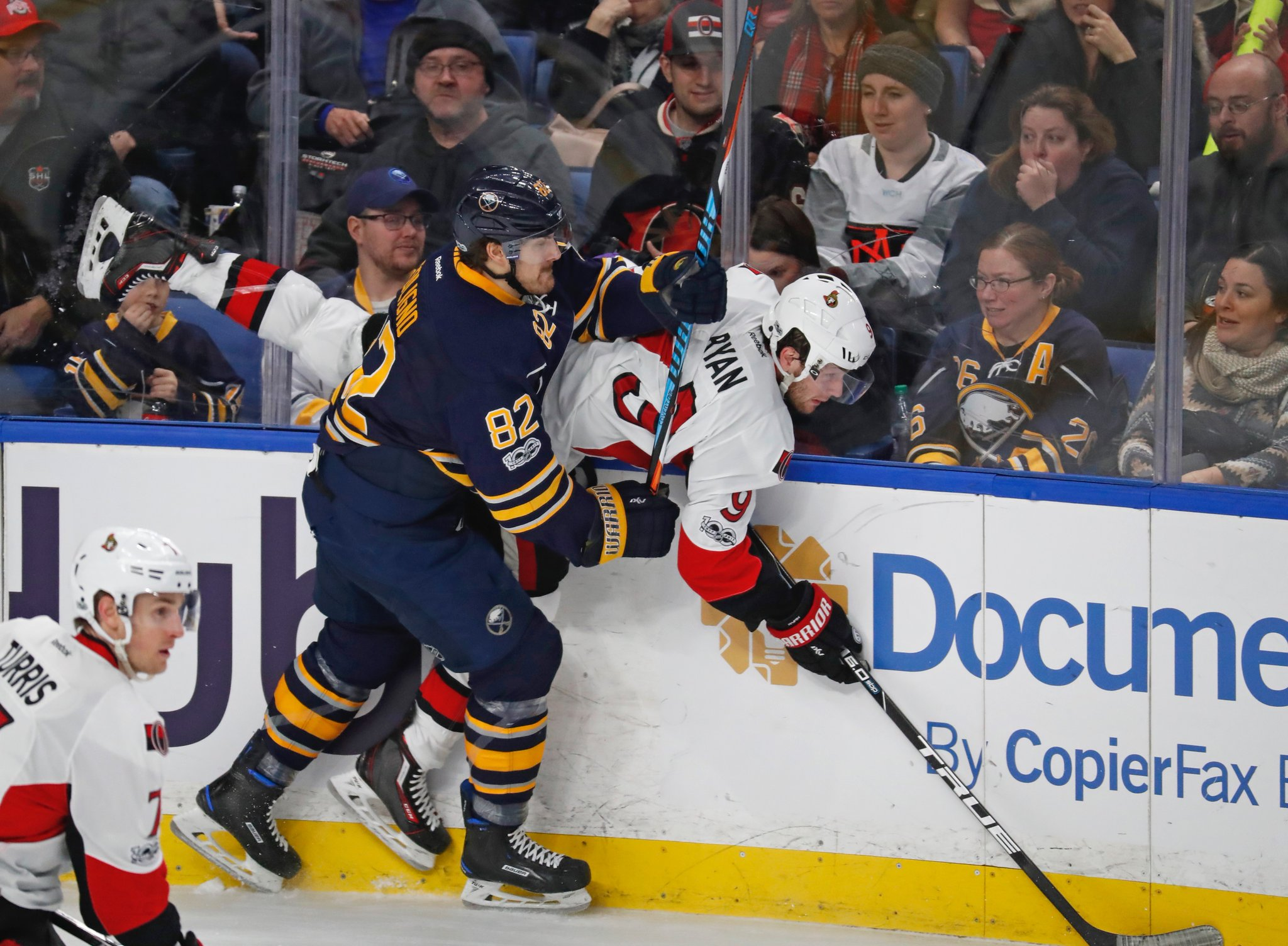The Sabres' Marcus Foligno introduces Ottawa's Bobby Ryan to the boards Saturday. (Harry Scull Jr./Buffalo News)