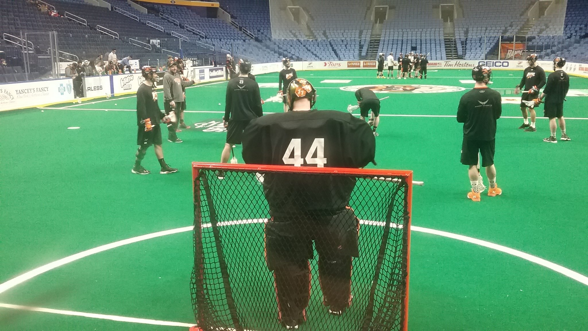 Assistant coach Rich Kilgour gives the defense some pointers during Saturday morning's practice by the Bandits.