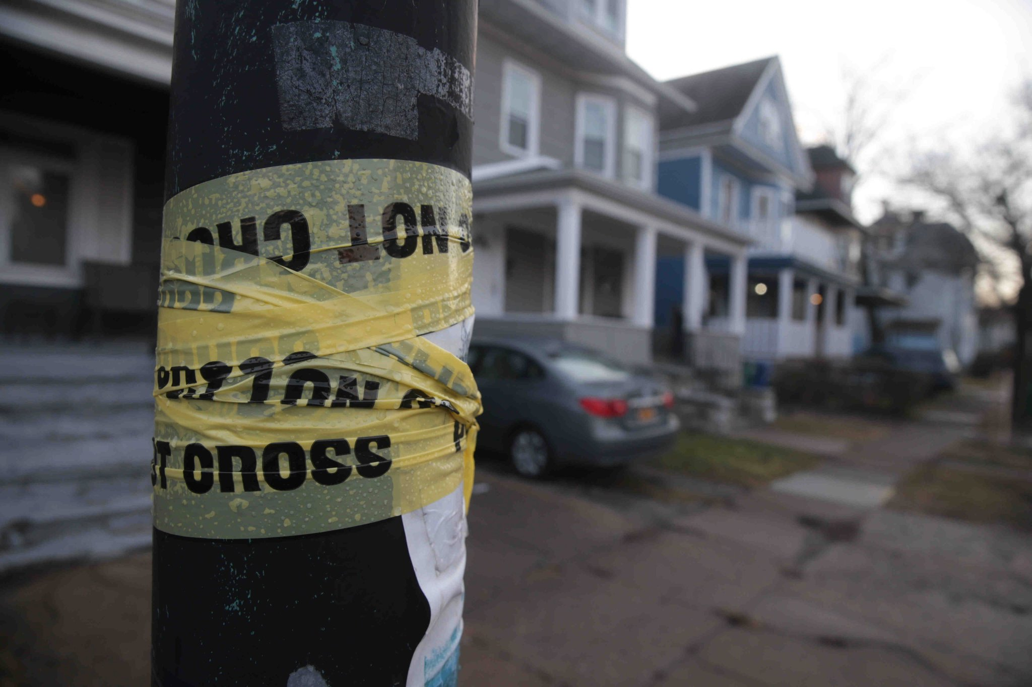Police tape surrounds a pole near Hoyt and Arnold streets where a man died in police custody late Tuesday night. (John Hickey/Buffalo News)