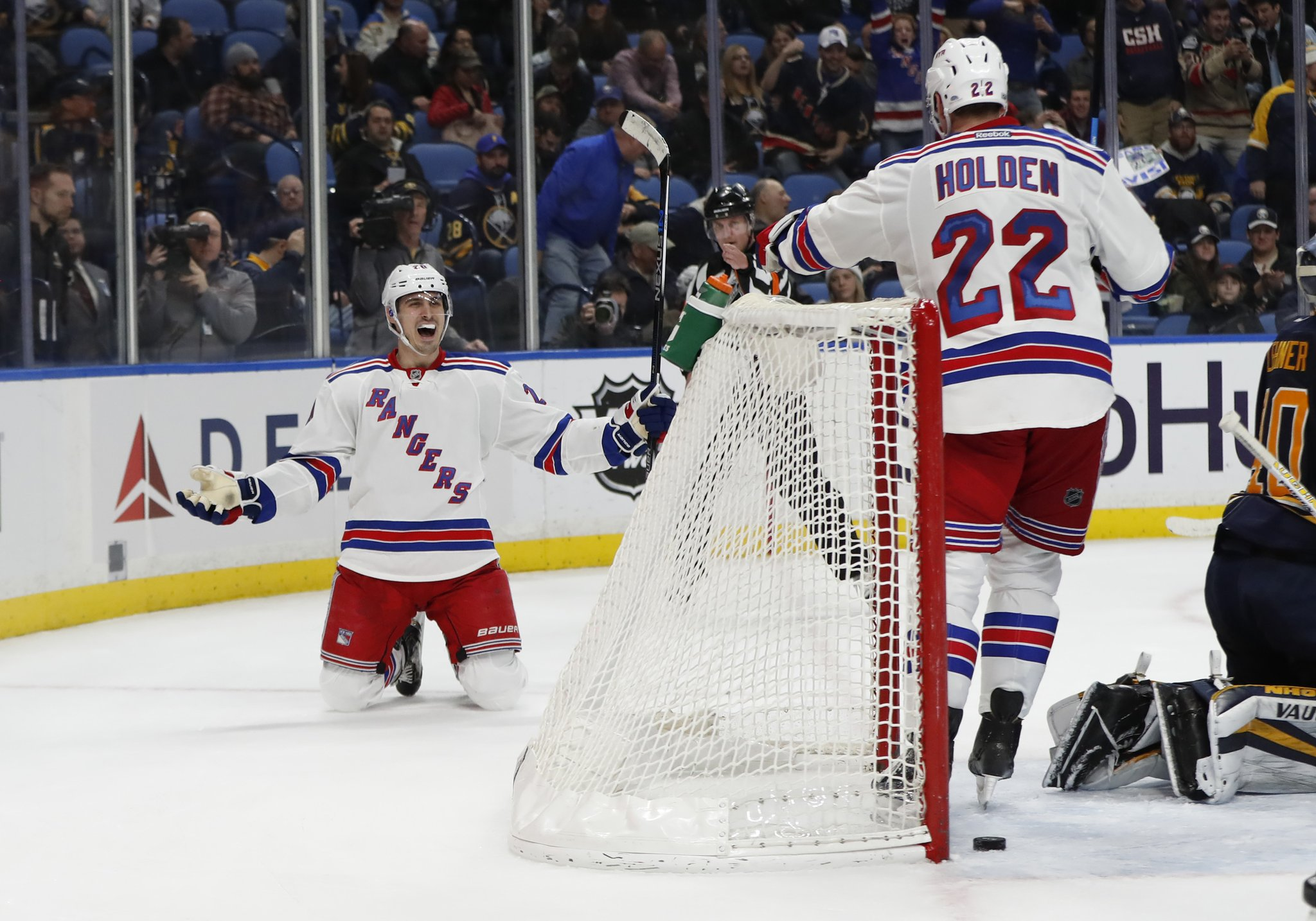 Chris Kreider celebrates his overtime winner with Rangers teammate Nick Holden. (Harry Scull Jr./Buffalo News)