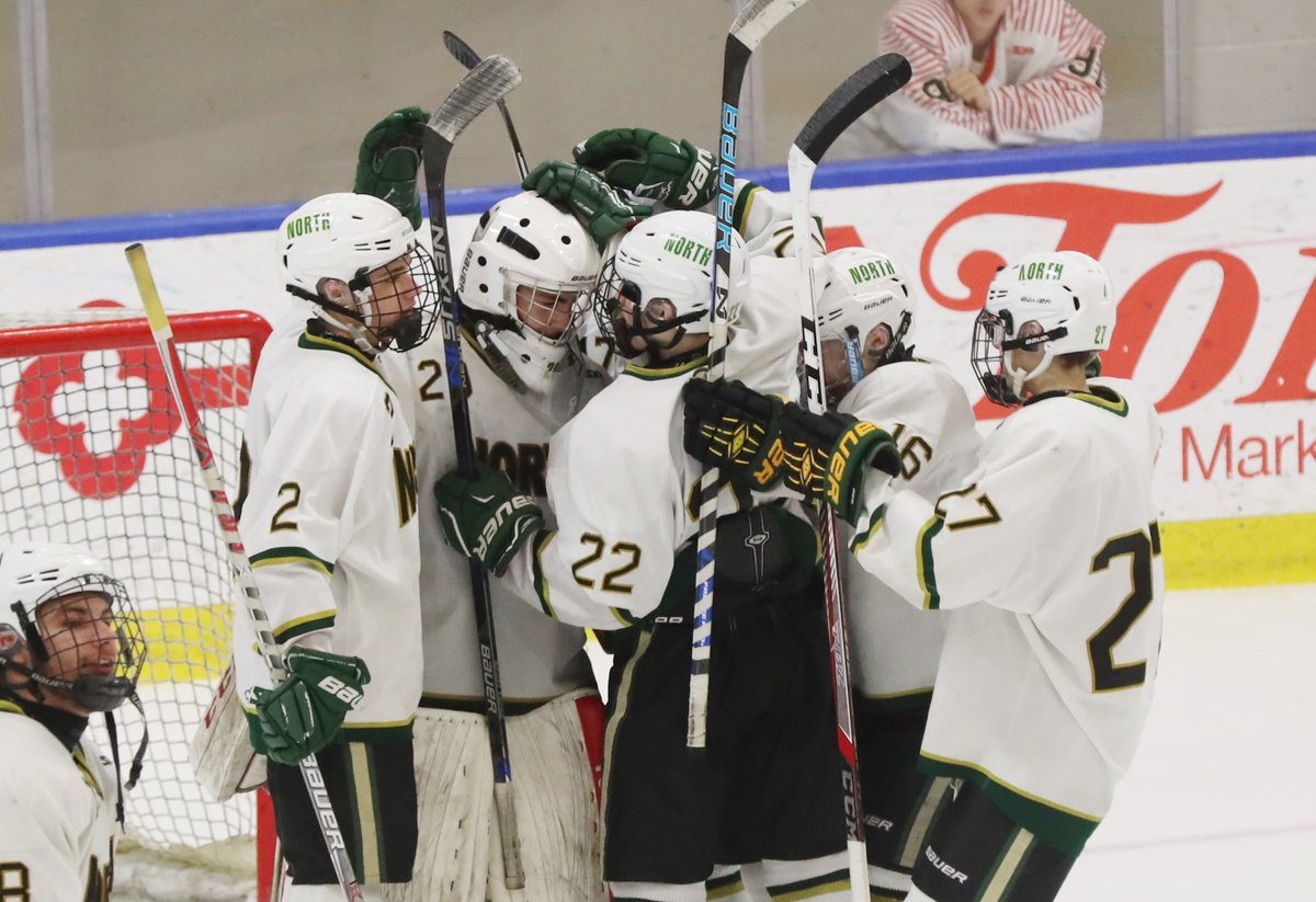 Williamsville North players congratulate goalie Jake Zurat after he made 12 stops during the Spartans' 5-0 Section VI Division I semifinal triumph over Niagara Falls on Tuesday night at HarborCenter. (James P. McCoy/Buffalo News)