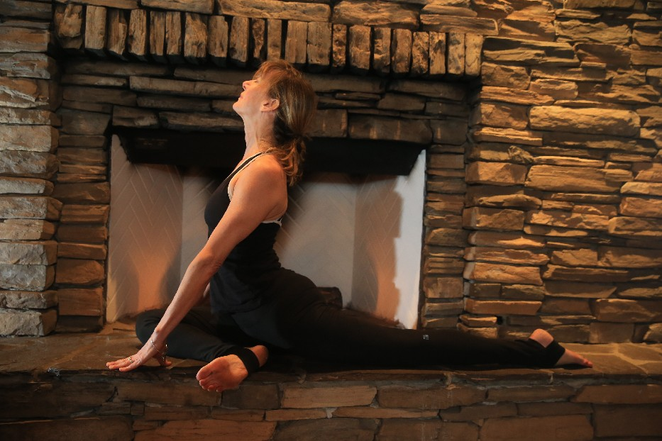 Sue Zinter, a massage therapist and yoga instructor on Grand Island, teaches zin yoga, which involves holding poses, deliberately, for up to several minutes. (Photos by John Hickey/Buffalo News)