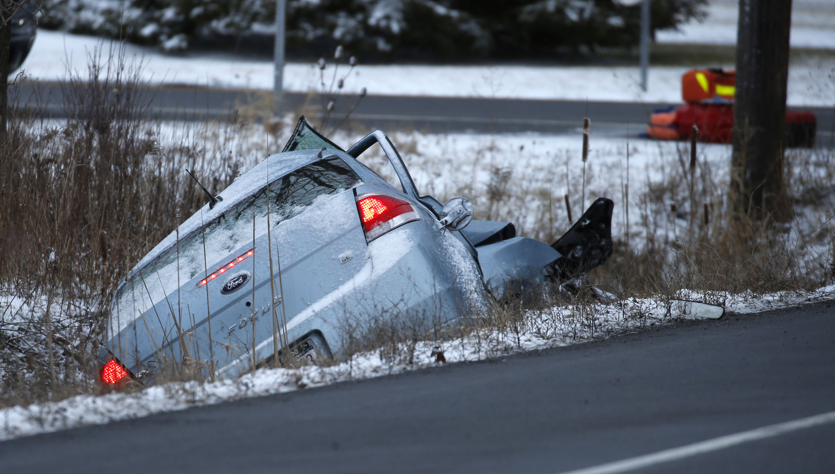 This car was traveling north on Hoover Road in Sanborn when it collided with a automobile transport truck that was traveling west on Lockport Road on  Wednesday, Feb. 15, 2017.  The lone passenger in the car was killed.  (Robert Kirkham/Buffalo News)