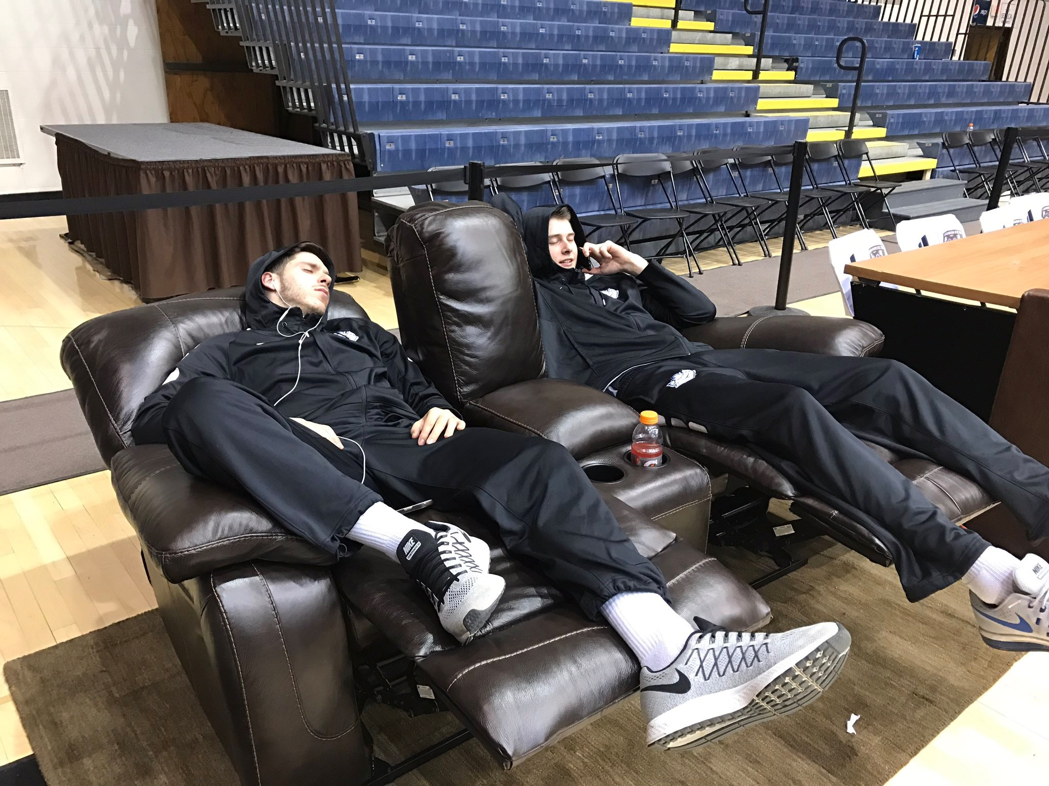St. Louis University basketball players doze in the Reilly Center after their bus driver went AWOL Wednesday night. (Photo St. Louis University basketball)