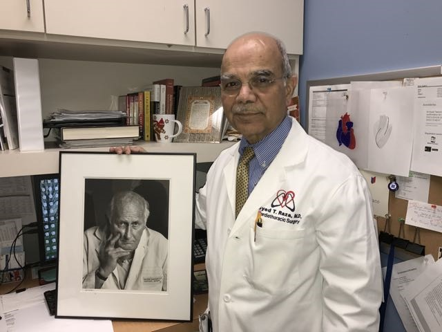 Dr. Syed Raza, a cardiac surgeon for more than 30 years in Buffalo, keeps a photograph at his Columbia Medical Health Center office of Dr. George Schimert, pioneering cardiac surgeon in Western New York - and Raza's mentor. (image courtesy Dr. Syed Raza).