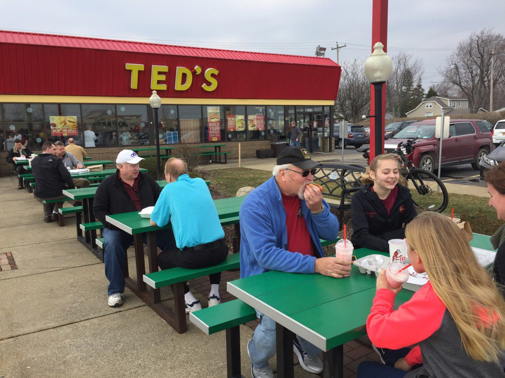 People enjoy 90-cent hot dogs and mild weather at Ted's Hot Dogs on Transit Road on Wednesday. (Sharon Cantillon/ Buffalo News)