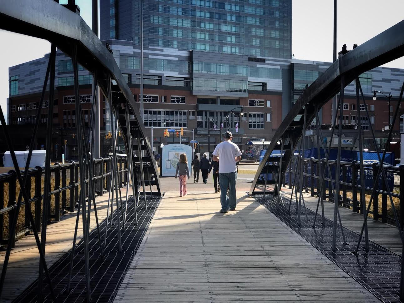 Visitors enjoy the balmy temperatures at Canalside at lunchtime  Friday. (Cathaleen Curtiss/Buffalo News)