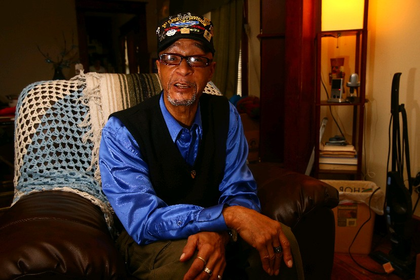 Vietnam veteran Harold L. Pope Jr., recalling the war in his Buffalo home, would like to reconnect with a combat buddy he shared a special song with. (John Hickey/Buffalo News)
