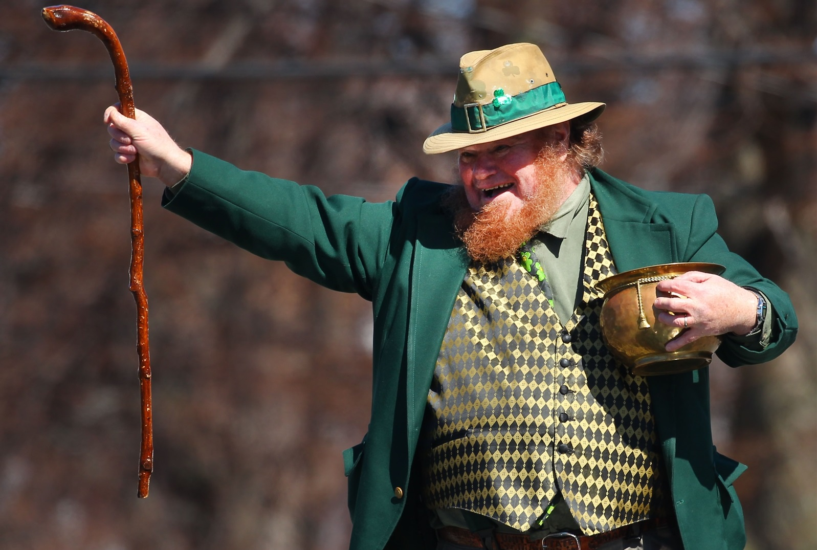 A dressed-up leprechaun greets the crowd at the 2016 Old Neighborhood St. Patrick's Day Parade. (Mark Mulville/Buffalo News file photo)