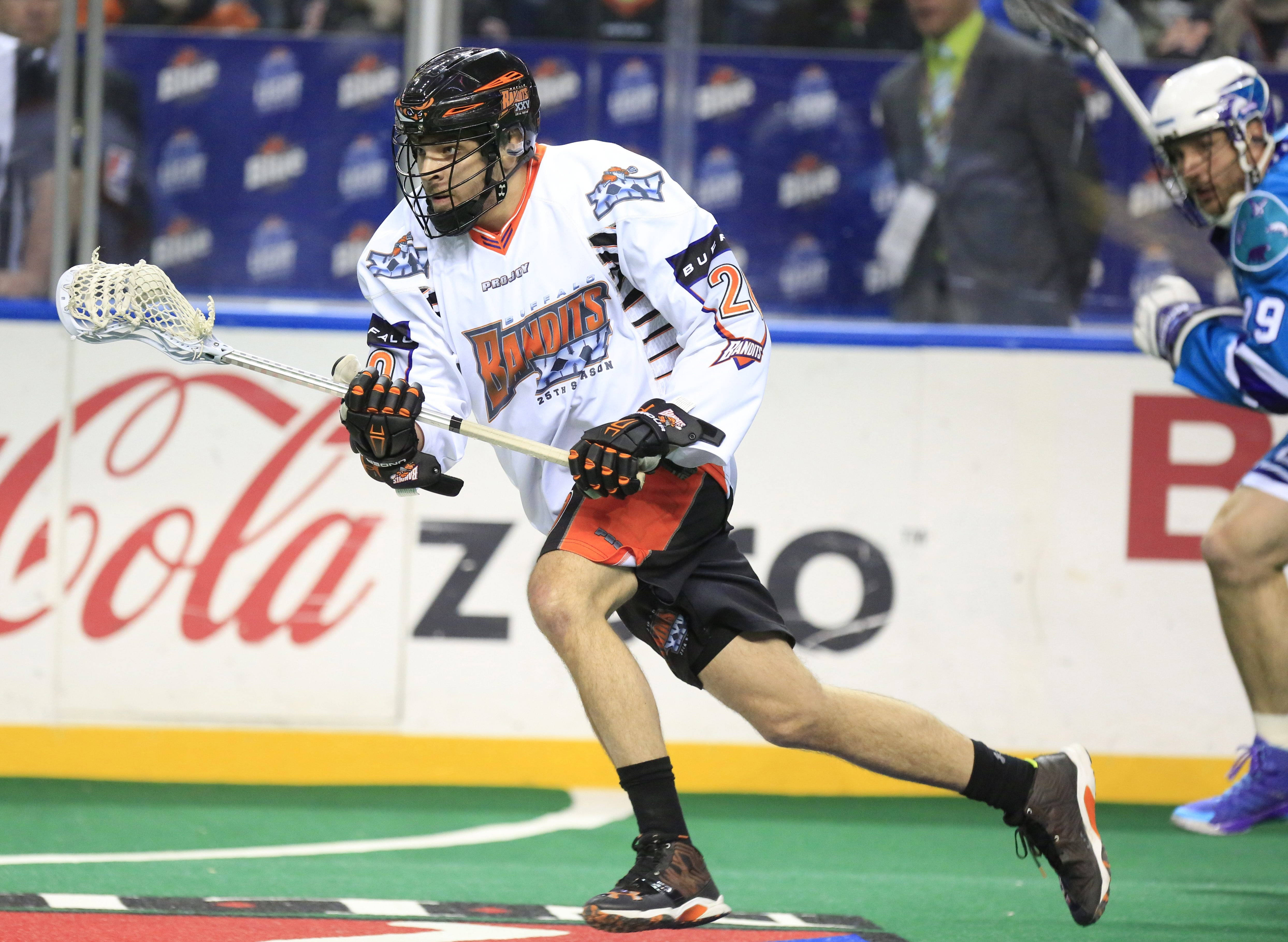 The Buffalo Bandits' Nick Weiss grabs a loose ball against the Rochester KnightHawks during action last season. (Harry Scull Jr./Buffalo News)