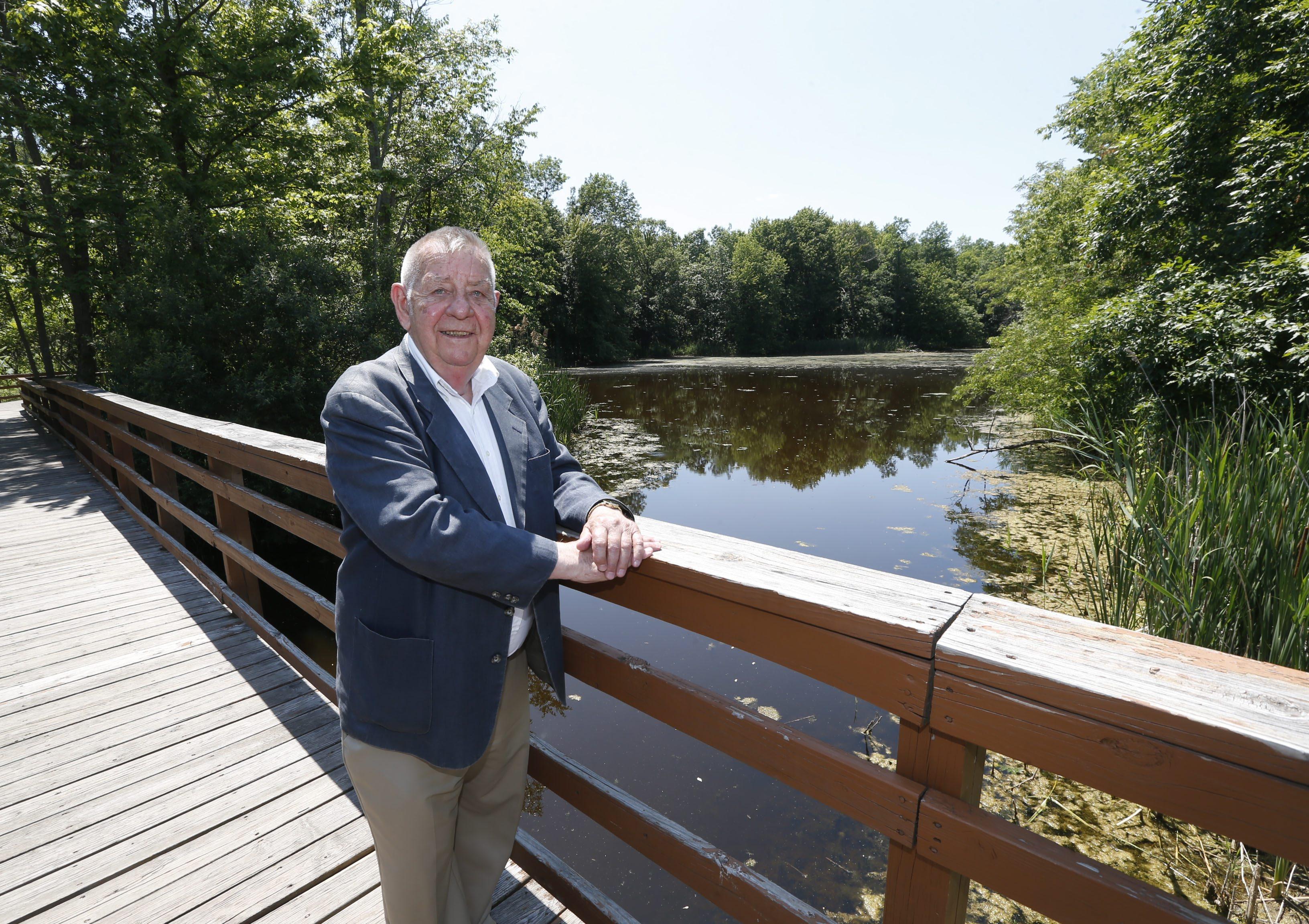 Former Amherst Town Board Member Bill Kindel stands on a foot bridge at Billy Wilson Park on Friday, June 24, 2016.  (Robert Kirkham/Buffalo News)