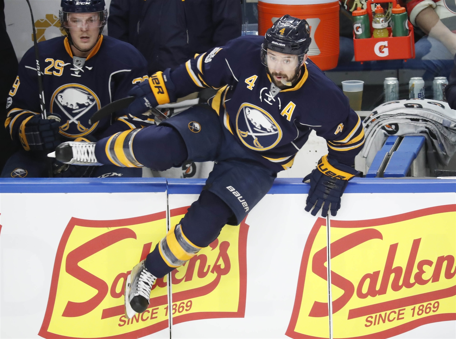 Sabres defensemen Josh Gorges (4) and Jake McCabe are under contract for next season. (Harry Scull Jr./Buffalo News)