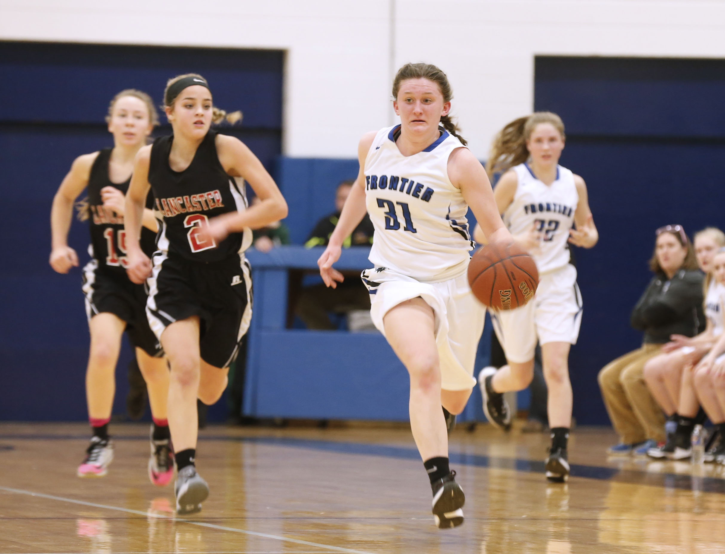 Frontier's Claire Kruska drives after a steal against Lancaster Friday in a Section VI Class AA semifinal.  (Robert Kirkham/Buffalo News)