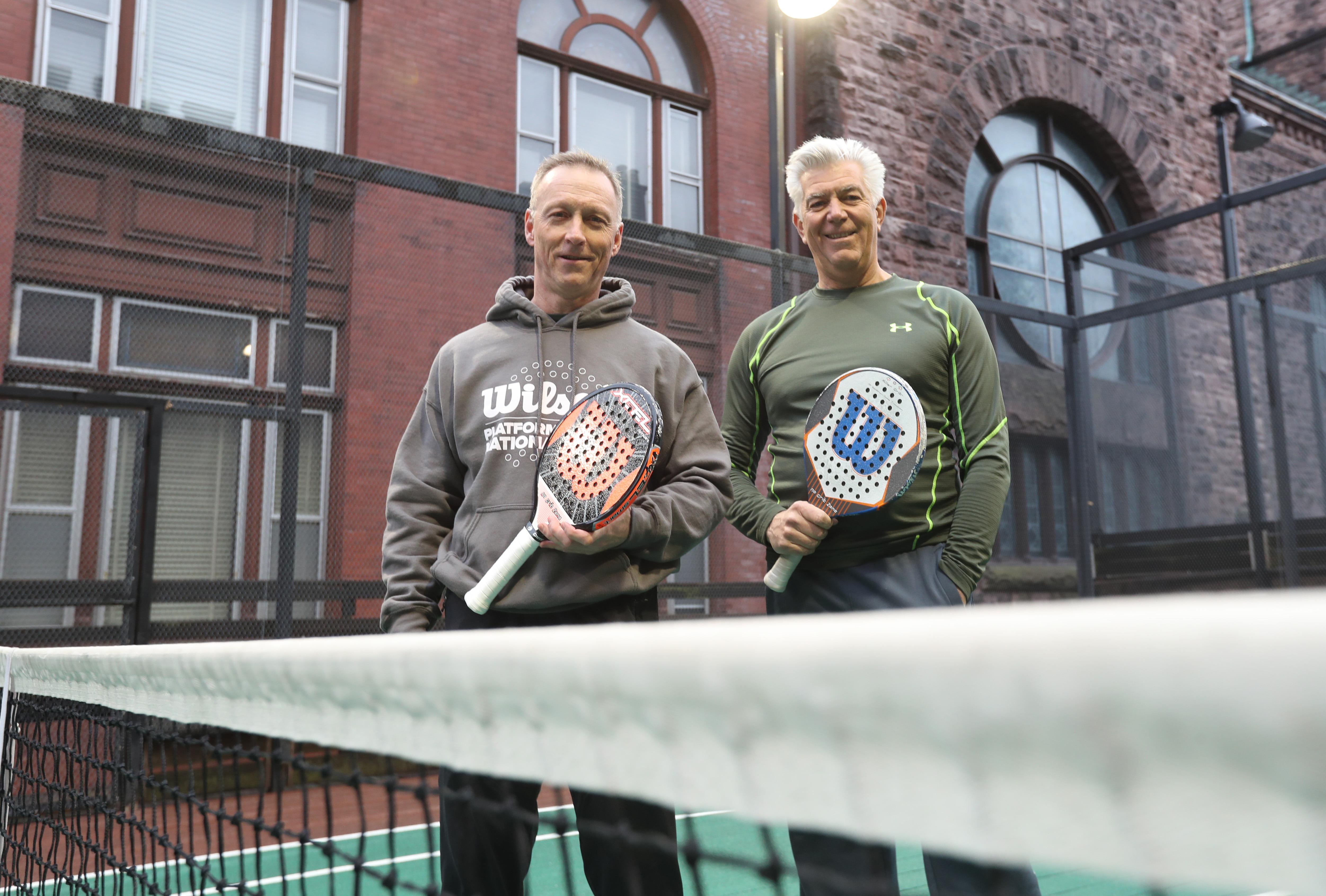 Platform tennis players Paul Herlan, left, and Chris Ross at Buffalo's Saturn Club. (James P. McCoy/Buffalo News)
