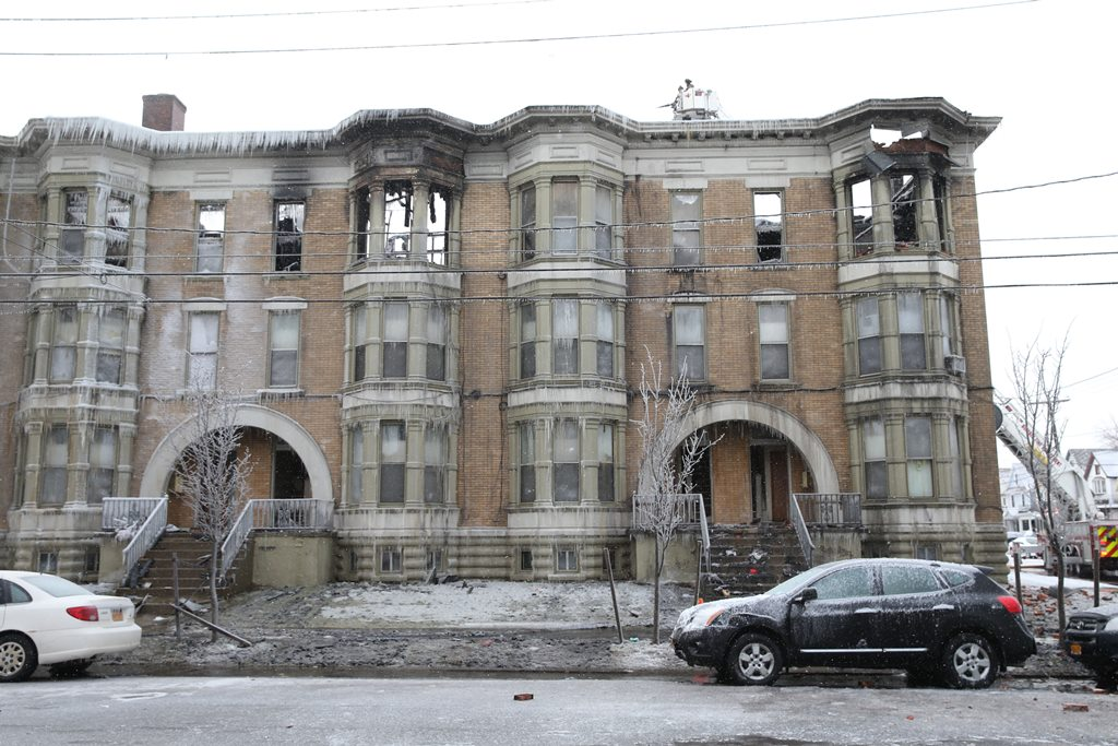 Buffalo Firefighters continue to battle Lafayette apartment  blaze Saturday in freezing temperatures.(Sharon Cantillon/Buffalo News)