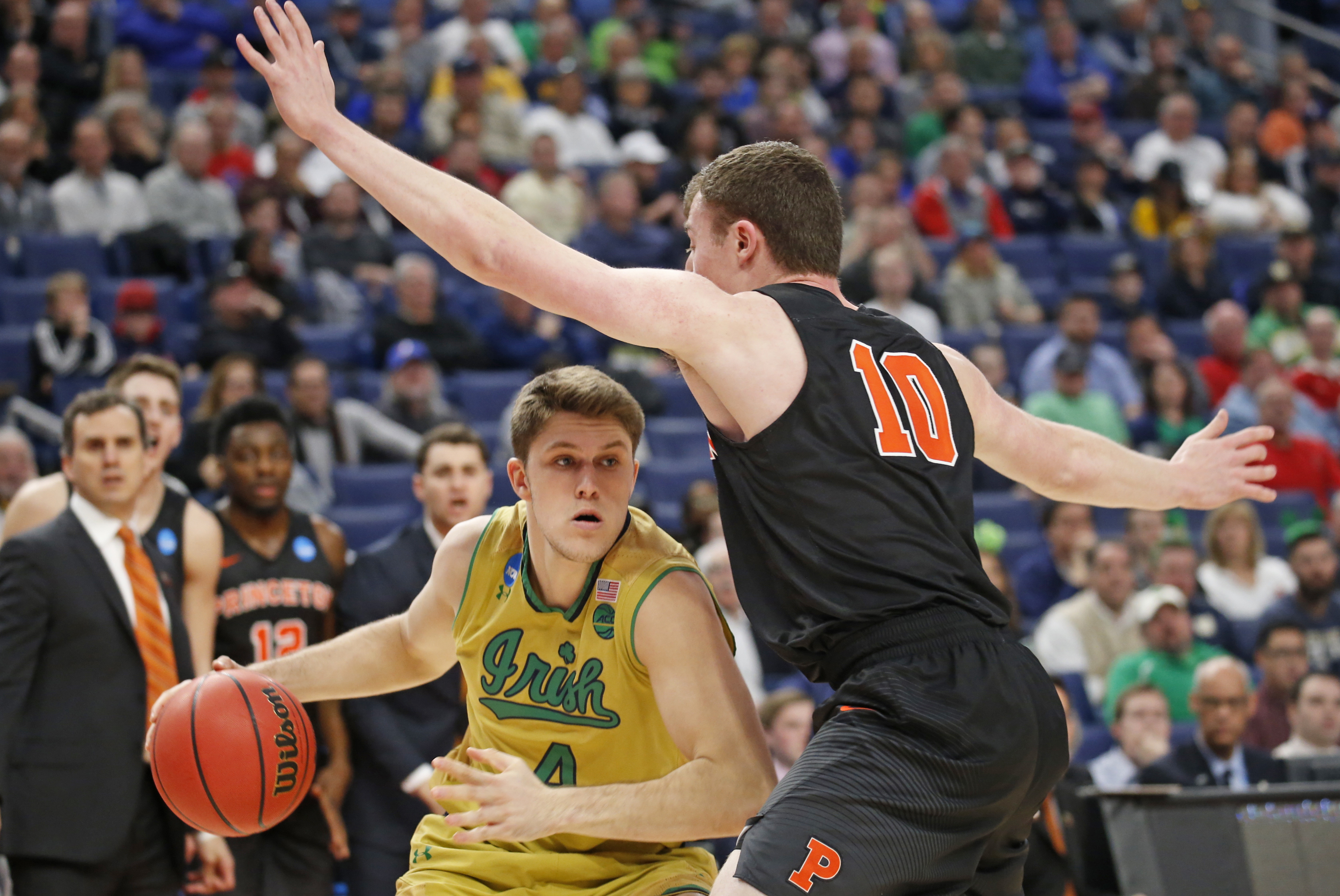 Notre Dame's Matt Ryan decides to go low beneath Princeton's Spencer Welsz. (Robert Kirkham/Buffalo News)