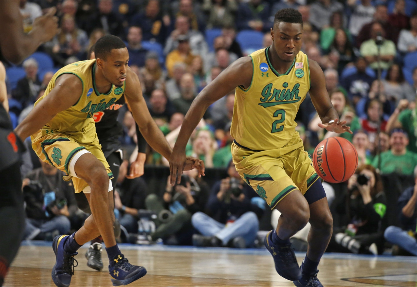 T.J. Gibbs (2), V.J. Beachem and Notre Dame will need to take care of the ball against West Virginia. (Robert Kirkham/Buffalo News)