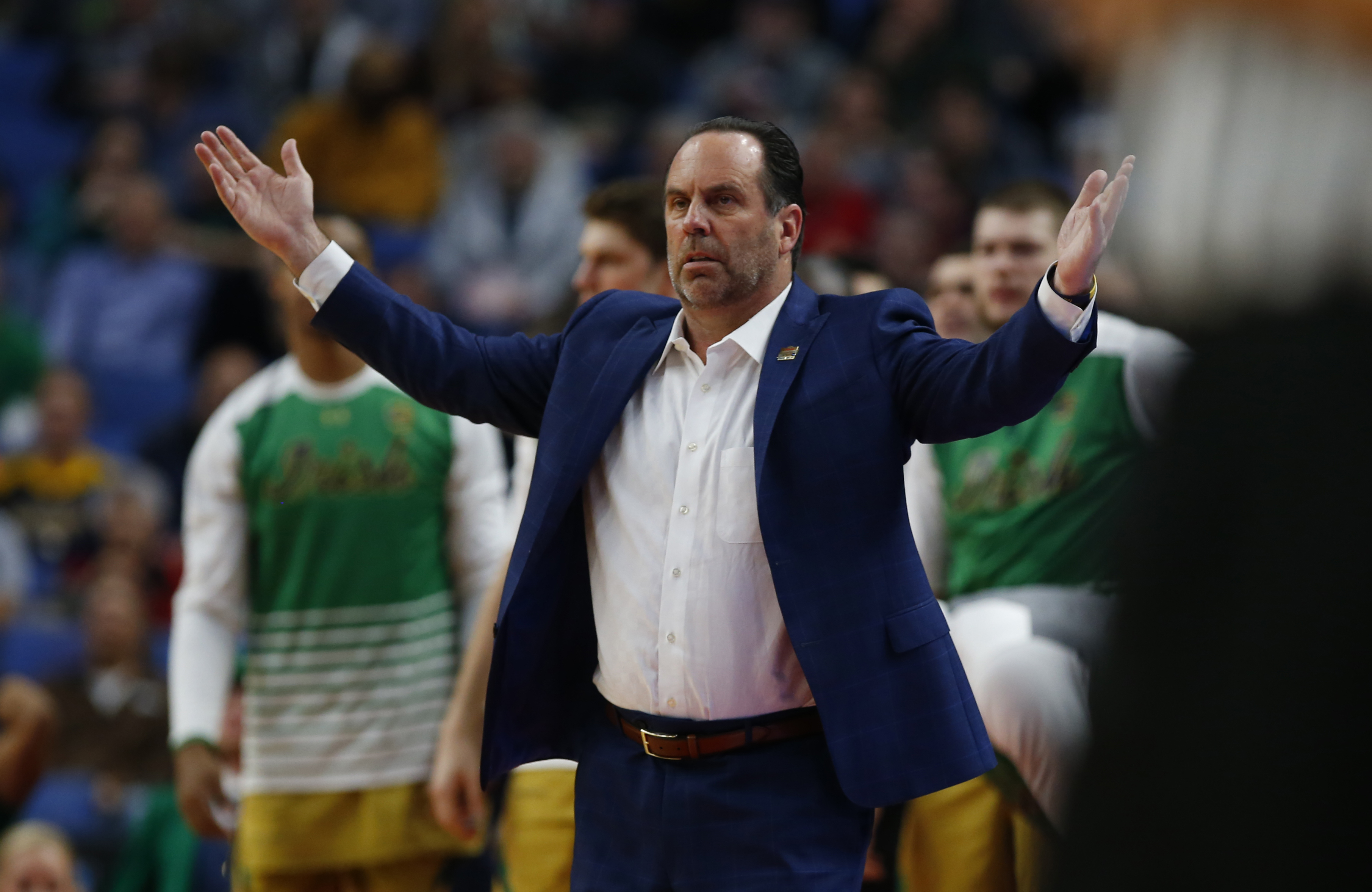 Notre Dame coach Mike Brey questions a call against West Virginia during first half action of the second round of the 2017 NCAA Men's Basketball Tournament at the KeyBank Center on Saturday, March 18, 2017. (Harry Scull Jr./Buffalo News)